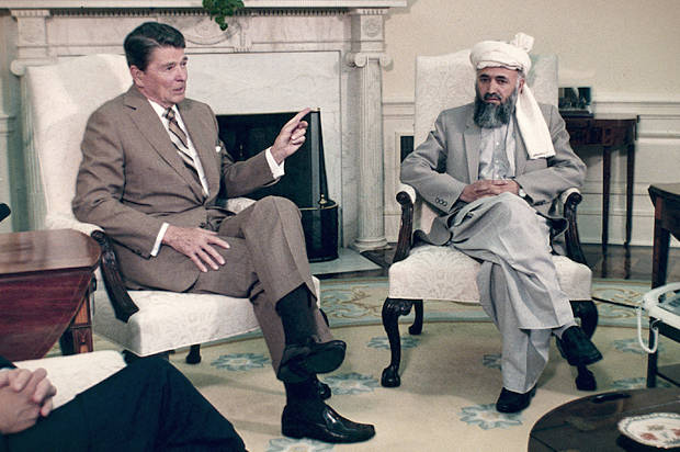 President Ronald Reagan gestures while talking to Burhaneddin Rabbani, a spokesman for the Afghan Resistance Alliance, at the White House in Washington, June 16, 1986. (AP Photo/Dennis Cook)