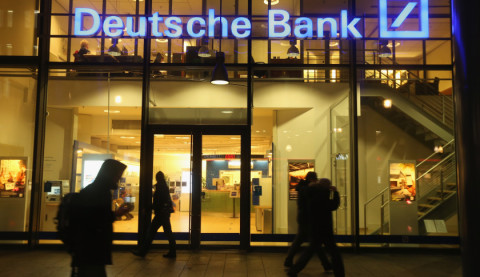 BERLIN, GERMANY - FEBRUARY 09: People walk past a branch of Deutsche Bank on February 9, 2016 in Berlin, Germany. Shares of Deutsche Bank rose 16% on the Frankfurt stock exchange on February 10 following rumours the bank may announce a bond buy-back initiative. (Photo by Sean Gallup/Getty Images)